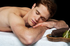 Handsome man relaxing at the spa Royalty Free Stock Images