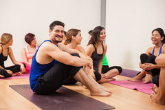 Handsome man relaxing after yoga class Royalty Free Stock Photo