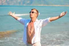 Handsome man in the resort enjoys Royalty Free Stock Photo