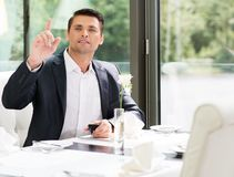 Handsome man in restaurant Royalty Free Stock Image