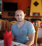 Handsome man in a restaurant Royalty Free Stock Images