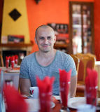 Handsome man in a restaurant Stock Images