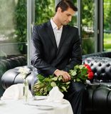 Handsome man in restaurant waiting Royalty Free Stock Images