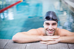 Handsome man resting on the edge. Of the pool Stock Photography