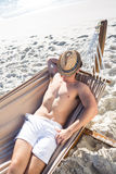 Handsome man resting in the hammock Royalty Free Stock Image
