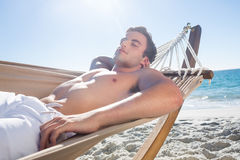 Handsome man resting in the hammock Royalty Free Stock Photos