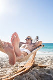 Handsome man resting in the hammock Royalty Free Stock Images