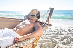 Handsome man resting in the hammock Stock Image