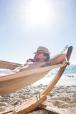 Handsome man resting in the hammock Stock Photography