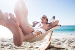 Handsome man resting in the hammock. At the beach Royalty Free Stock Images