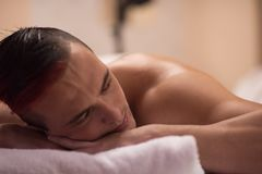 Free Handsome Man Resting In A Spa Massage Center Royalty Free Stock Photos - 93139138