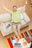 Handsome man resting on sofa at home Royalty Free Stock Image