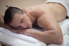 Handsome man resting in a spa massage center Royalty Free Stock Photo