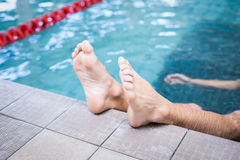 Handsome man resting in the water. In the pool Royalty Free Stock Photo