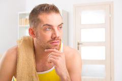 Handsome man resting after workouts Stock Images