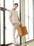 Handsome man with retro suitcase Royalty Free Stock Image
