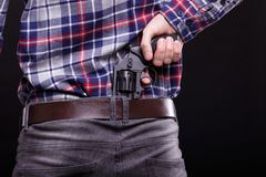 Handsome man with the revolver royalty free stock images