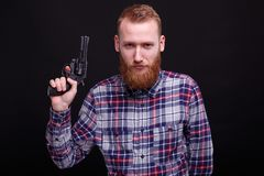 Handsome man with the revolver stock photography