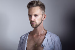 Handsome man with ripped open shirt royalty free stock image