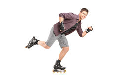 Handsome man roller skating Stock Photos