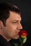 Handsome man with rose. Stock Image