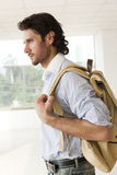Handsome man with a rucksack. Traveler with a rucksack or back pack Stock Photos