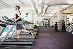 Handsome man running on treadmill Royalty Free Stock Photo