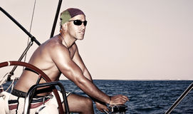 Handsome man on sail boat stock photography