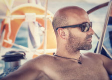 Handsome man on sailboat Stock Image