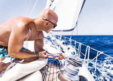 Handsome man on sailboat Stock Photography