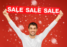 Handsome man with sale sign Royalty Free Stock Images