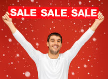 Handsome man with sale sign Stock Image
