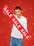 Handsome man with sale sign Stock Photos