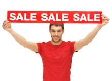 Handsome man with sale sign Royalty Free Stock Photos