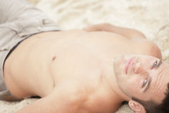 Handsome man on the sand Stock Image