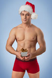 Handsome man with santa cap Stock Photography