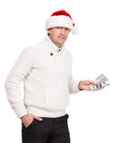 Handsome man in santa hat. Holding dollars on a white background Stock Photos