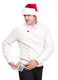 Handsome man in santa hat. Holding dollars on a white background Stock Photography