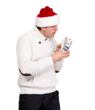 Handsome man in santa hat. Holding dollars on a white background Royalty Free Stock Photo