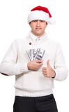 Handsome man in santa hat. Holding dollars on a white background Stock Image