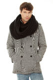 Handsome man in scarf and coat Stock Images