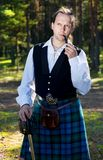 Handsome man in scottish costume Stock Image