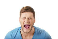 Handsome man screaming loud. Stock Photo