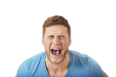 Handsome man screaming loud. Young handsome man screaming loud royalty free stock image