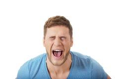 Handsome man screaming loud. Royalty Free Stock Image