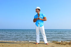 Handsome man by the sea Stock Photos