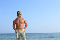 Handsome man by the sea Stock Images
