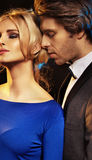 Handsome man seducing an elegant girl Stock Images