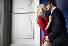 Handsome man seducing his pretty lady Stock Images