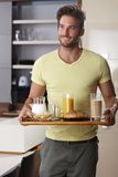 Handsome man serving breakfast for two Royalty Free Stock Image
